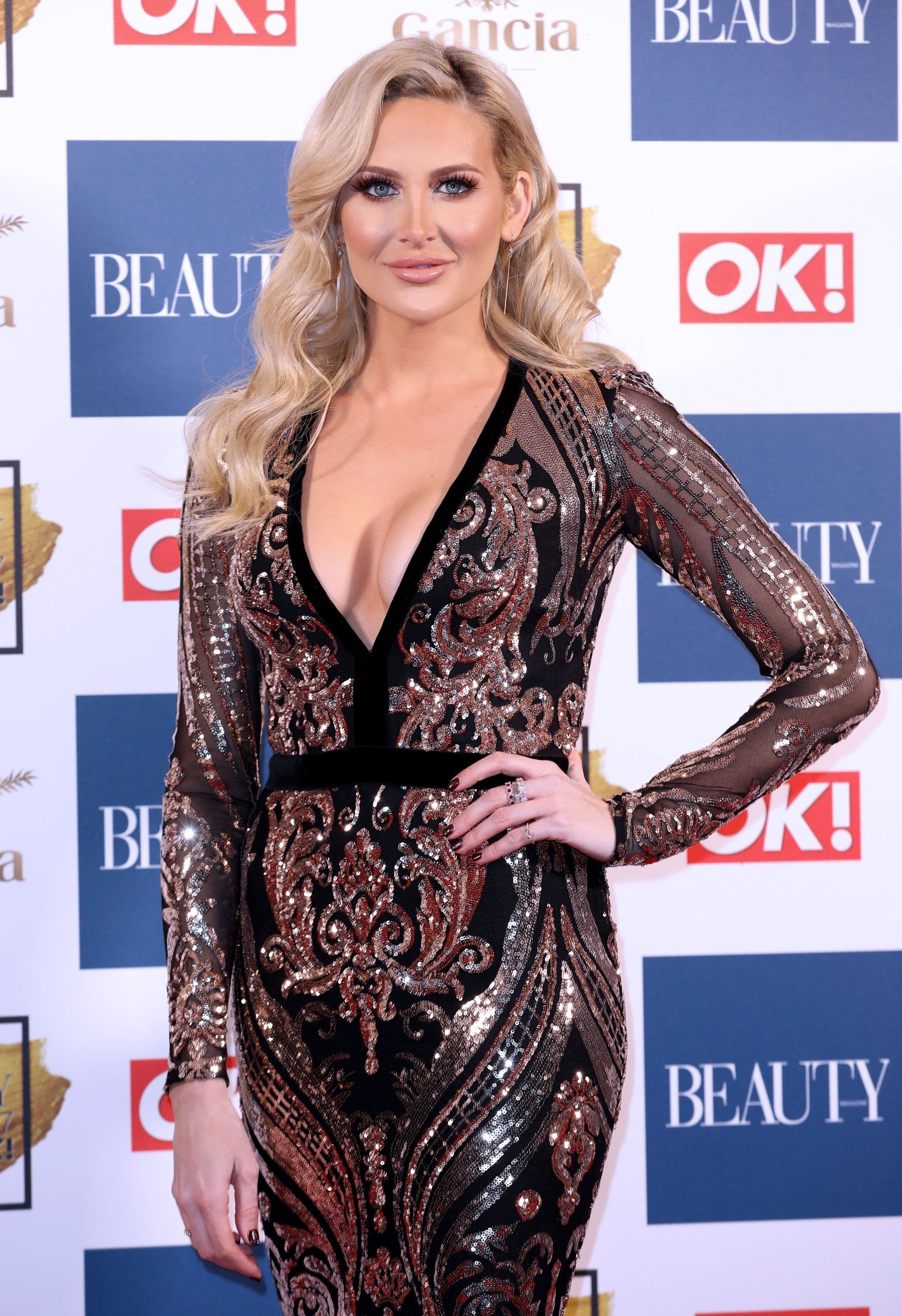 close up shot of stephanie pratt on the ok beauty awards red carpet with glam waves hairstyle, wearing sequin dress