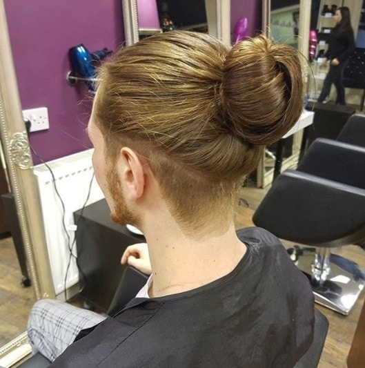 Man With A Brunette Bun Shaved Undercut Detail