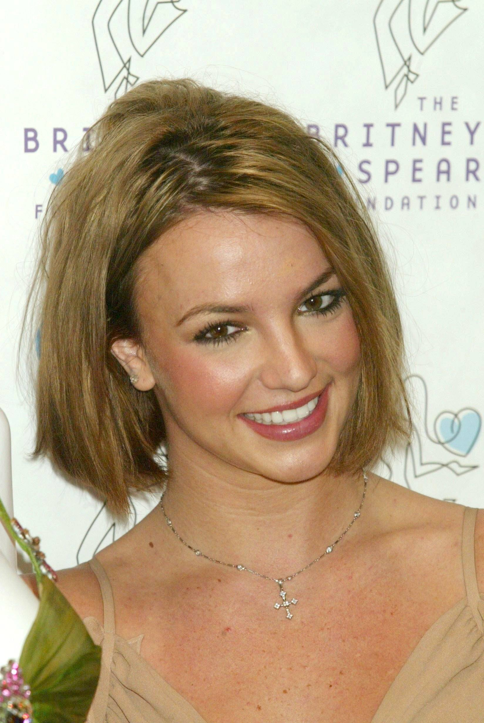 Singer Britney Spears With A Golden Brunette Bob Haircut