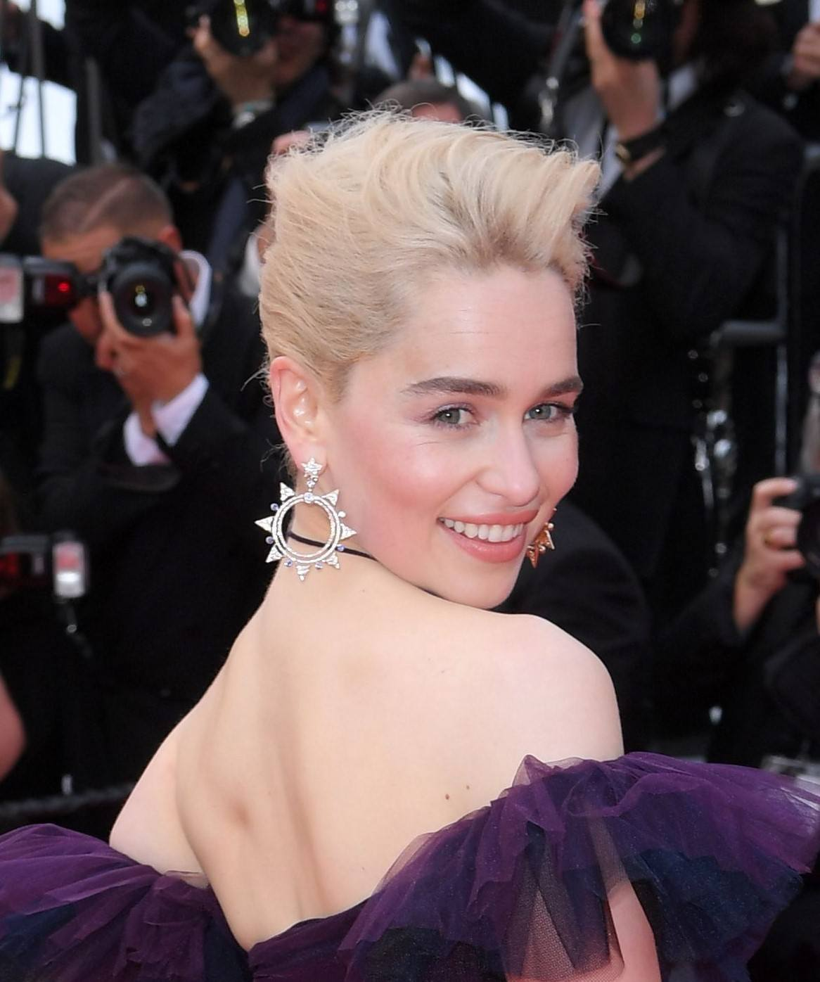 Formal hairstyles for short hair: Red carpet photo of Emilia Clarke with platinum blonde hair in a pompadour updo