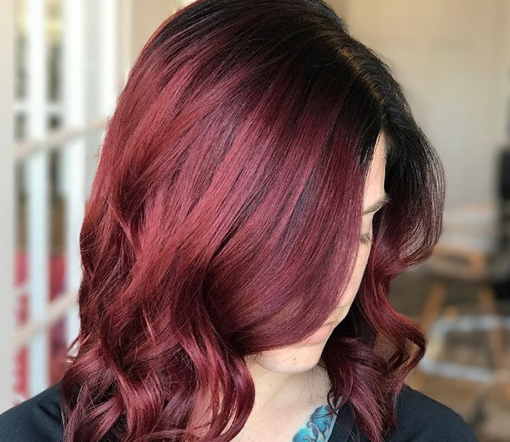 close up shot of woman with mulled wine ombre hair colour at a salon