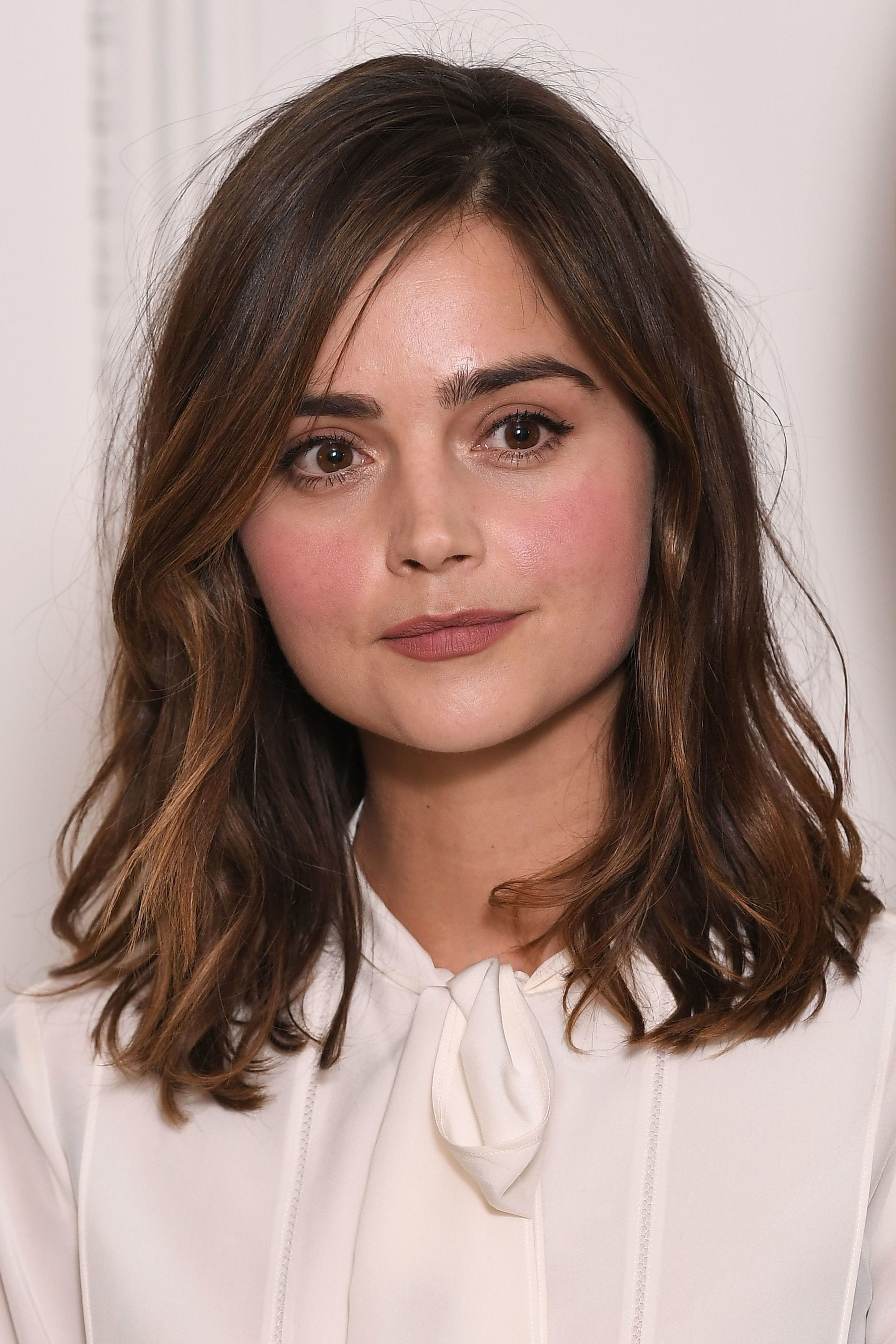 front view of Jenna Coleman with long bob and natural waves