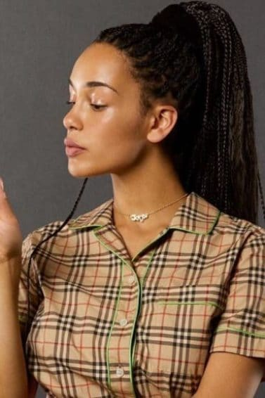 side view of Jorja Smith with dark box braids in high ponytail