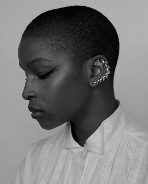 side view of julie adenuga with short buzzcut in black and white picture