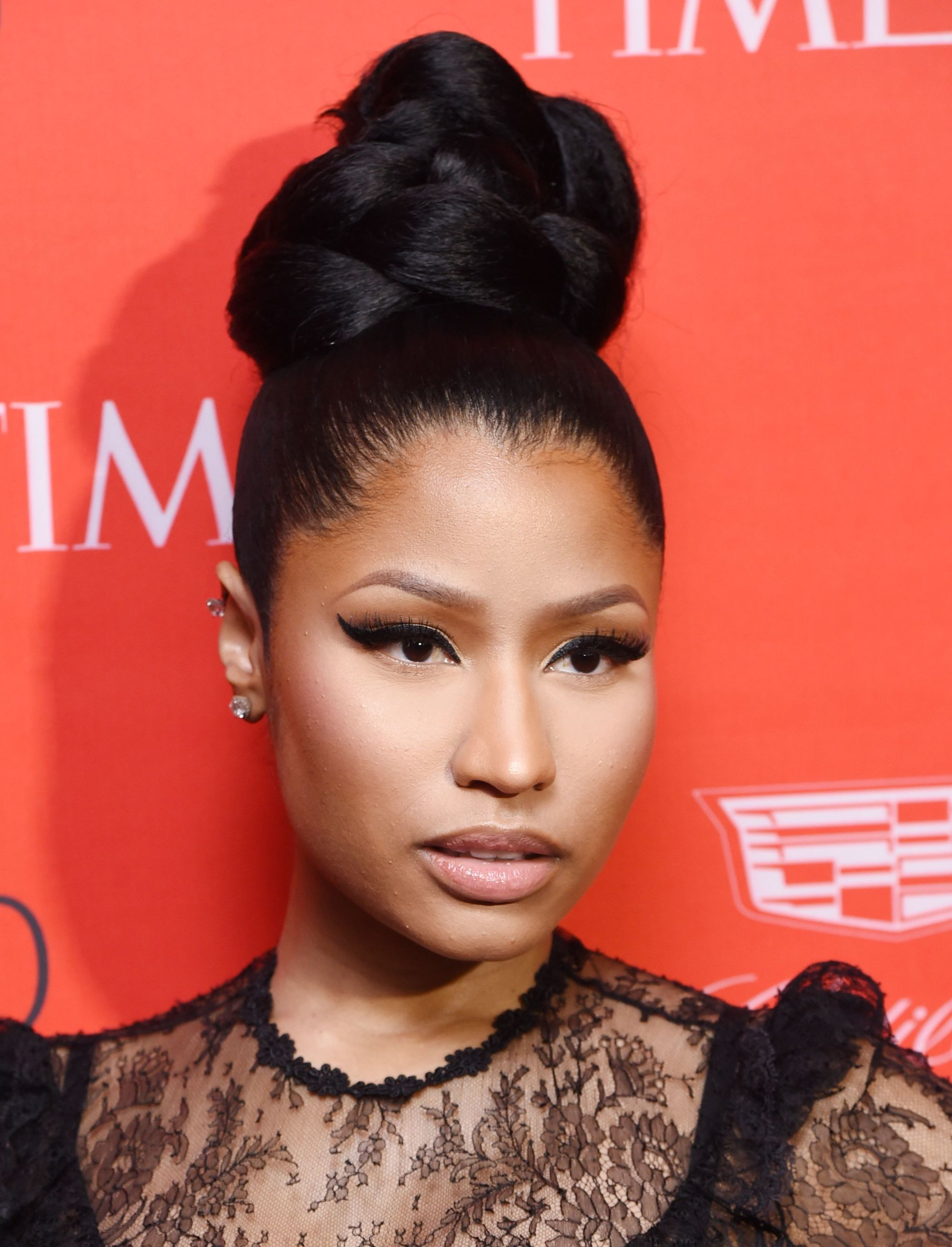 Front View Of Nicki Minaj With Dark Hair In High Braided Bun Updo
