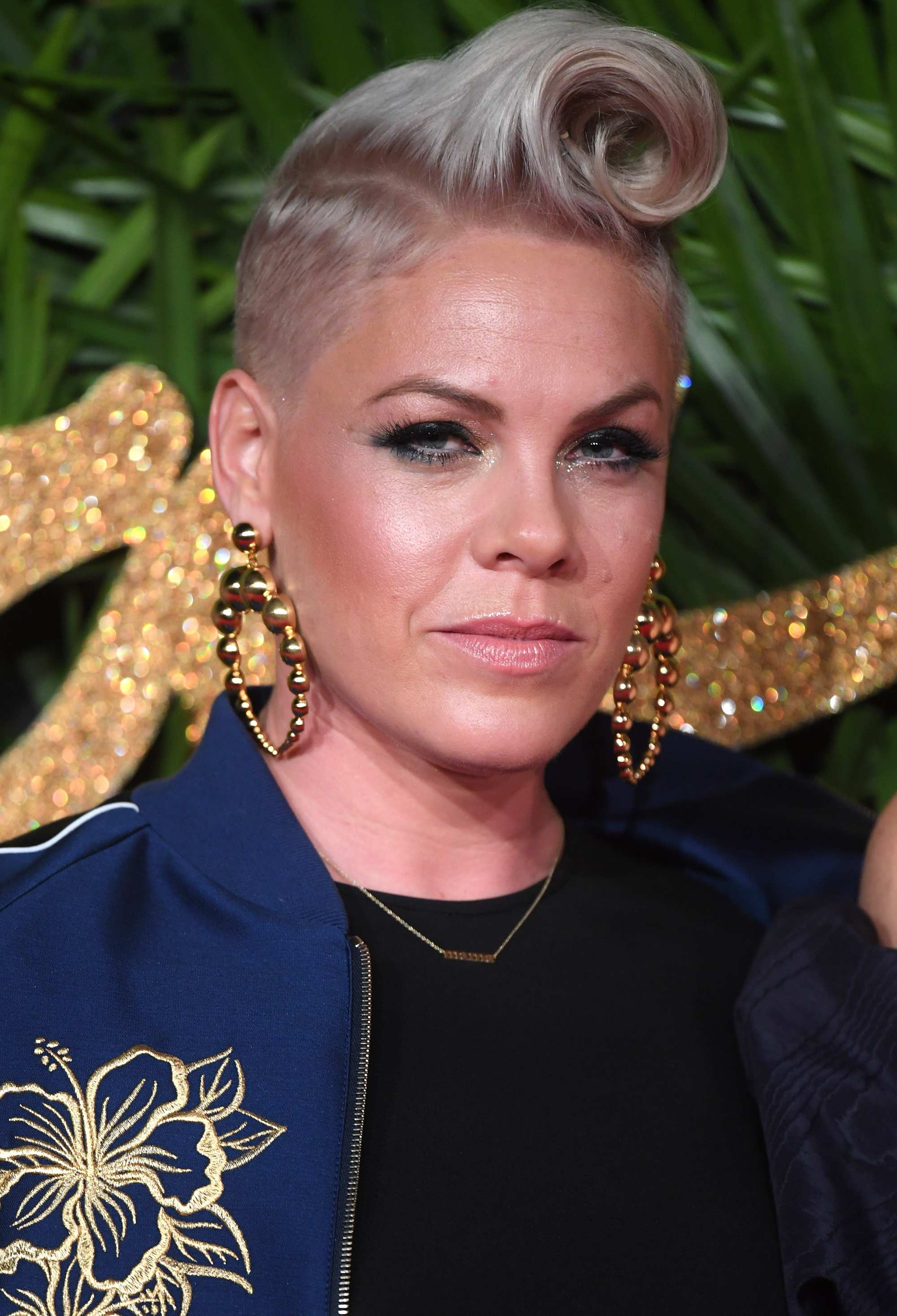 american singer pink at the british fashion awards with a rockabilly quiff hairstyle