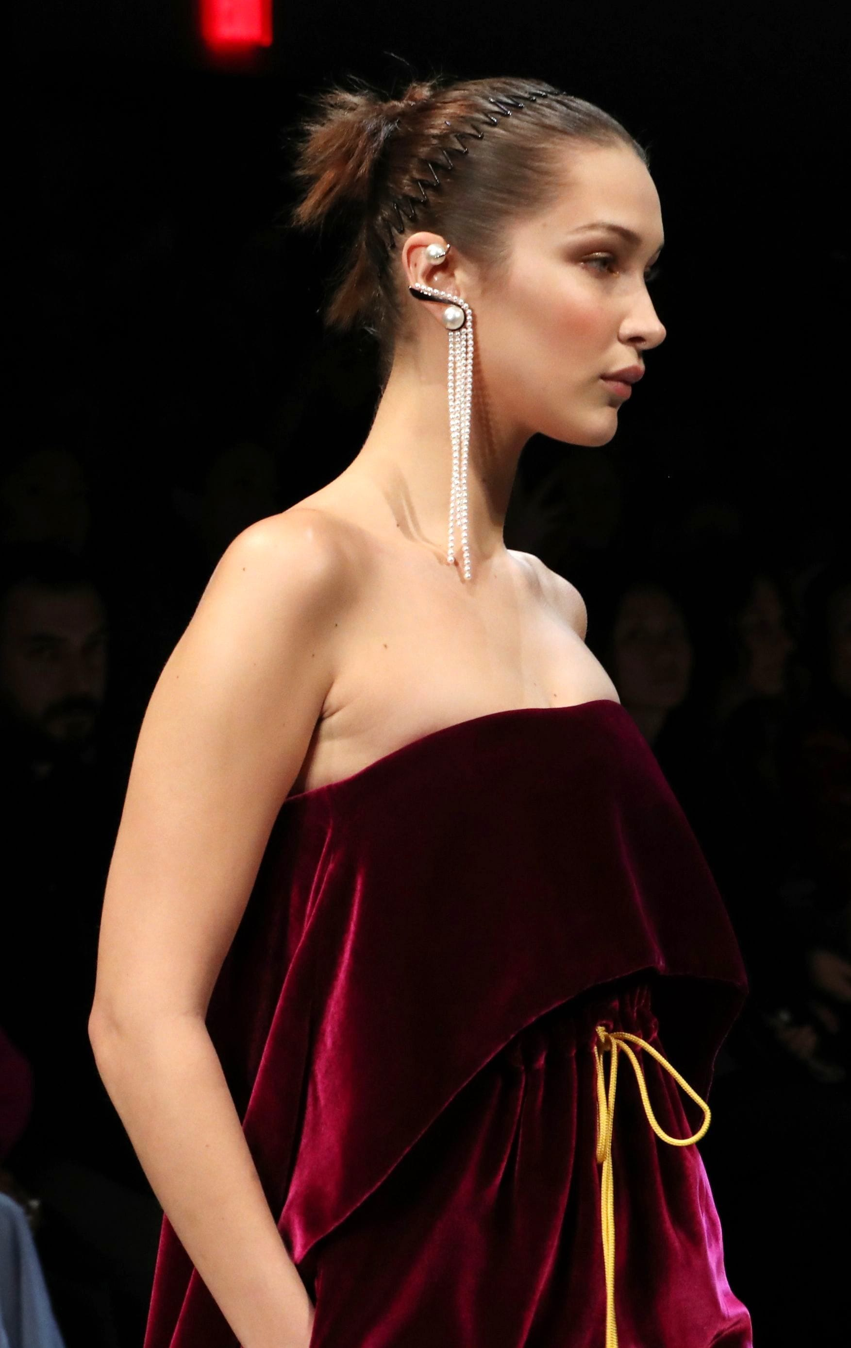 bella hadid brown hair in updo with '90s accordion headband on catwalk
