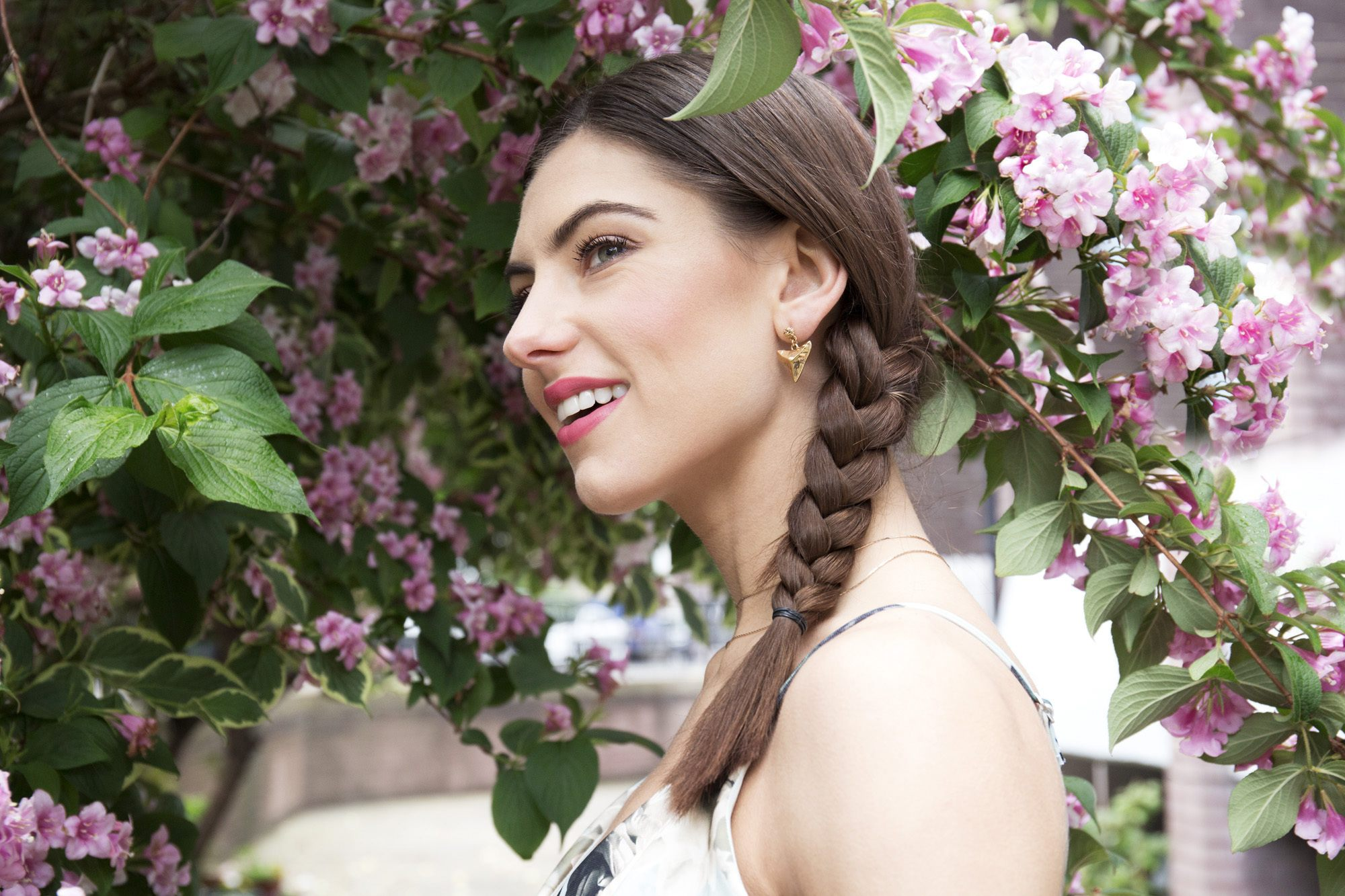 Side view of brunette model with side braid