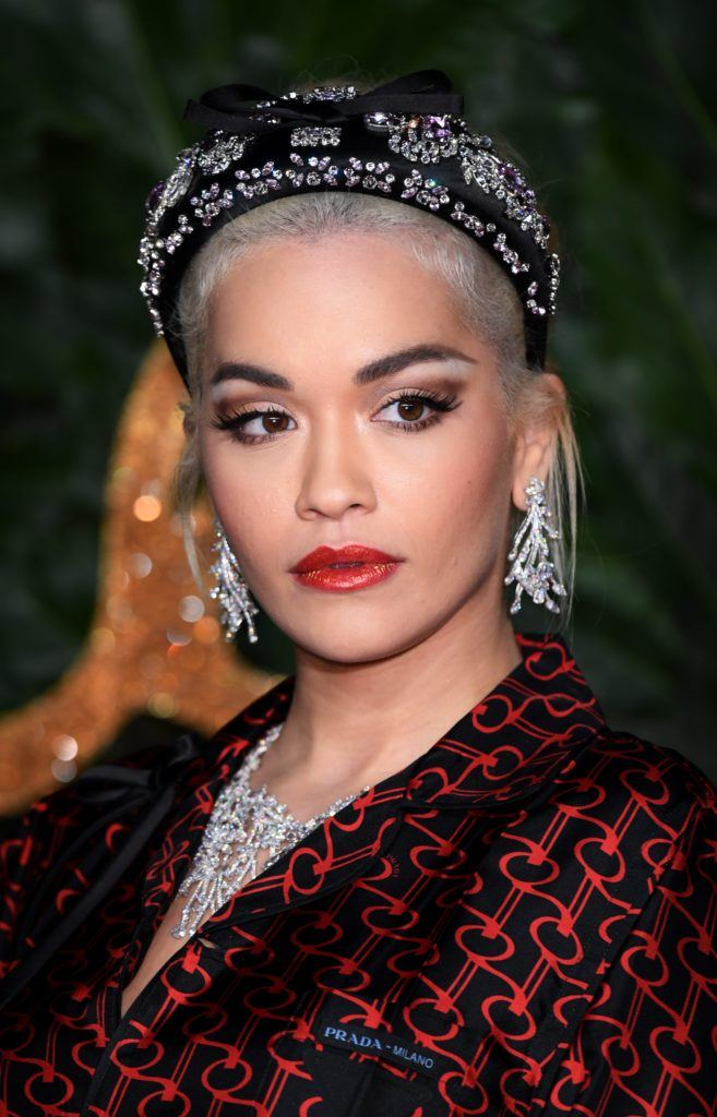 The Fashion Awards 2018: Rita Ora with white platinum blonde hair in an updo with a black puffy embellished headband