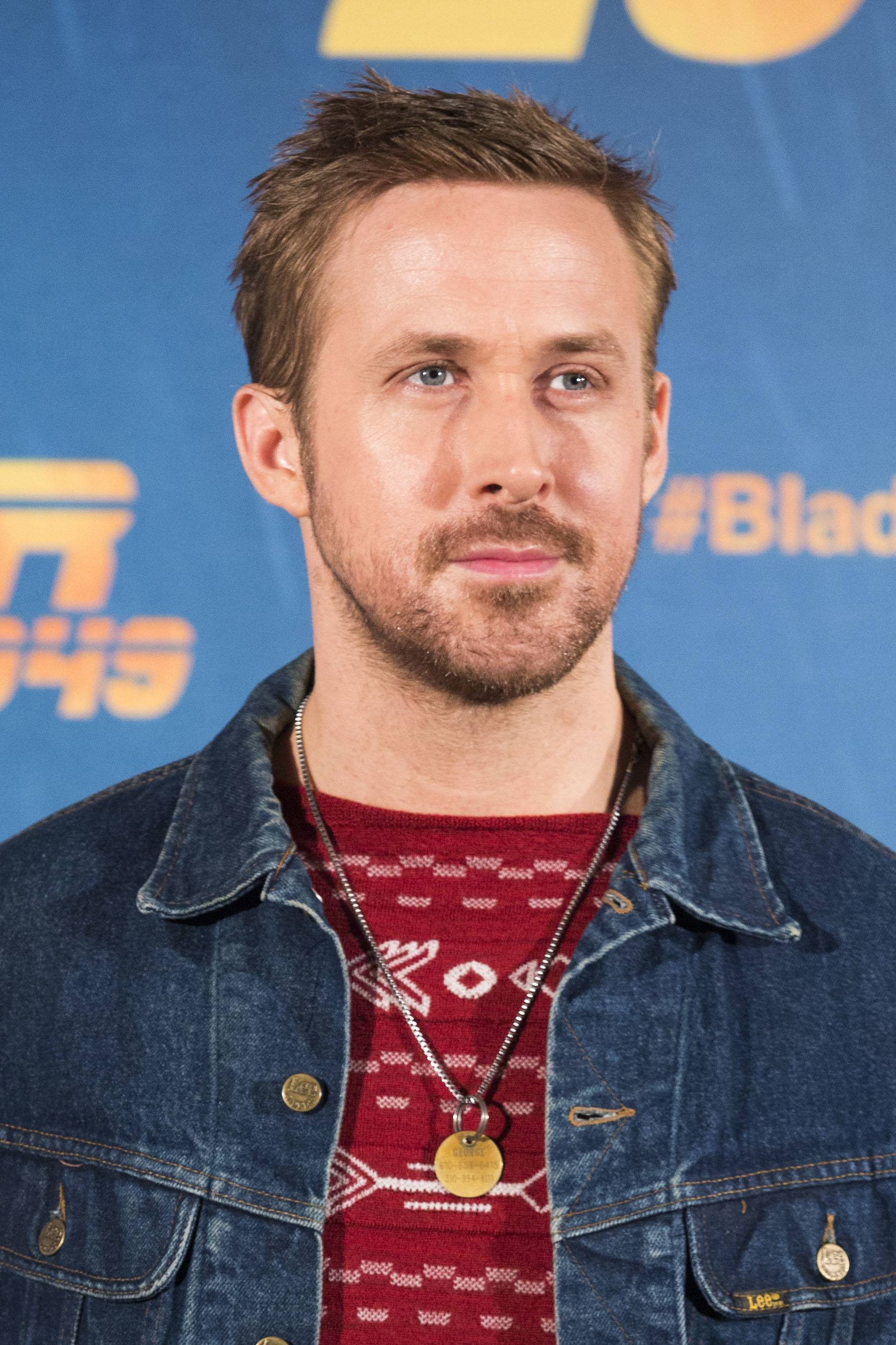 Ryan Gosling haircut: Ryan Gosling with a spiked-up crew cut haircut, wearing a red patterned top and a denim jacket
