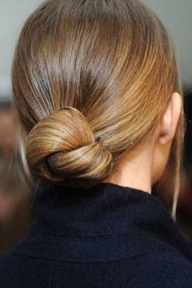back view of blonde hair in low knotted bun