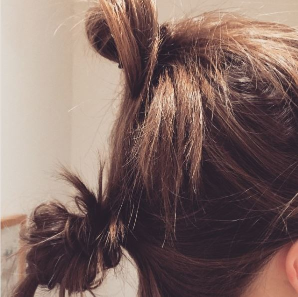 side view of brown hair in stacked double buns