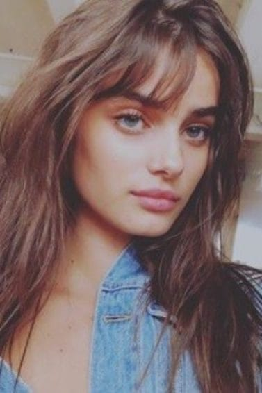 victoria's secret model taylor hill with long brunette wavy hair and birkin bangs