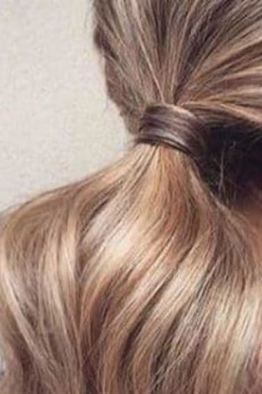 back view of blonde long hair in low ponytail