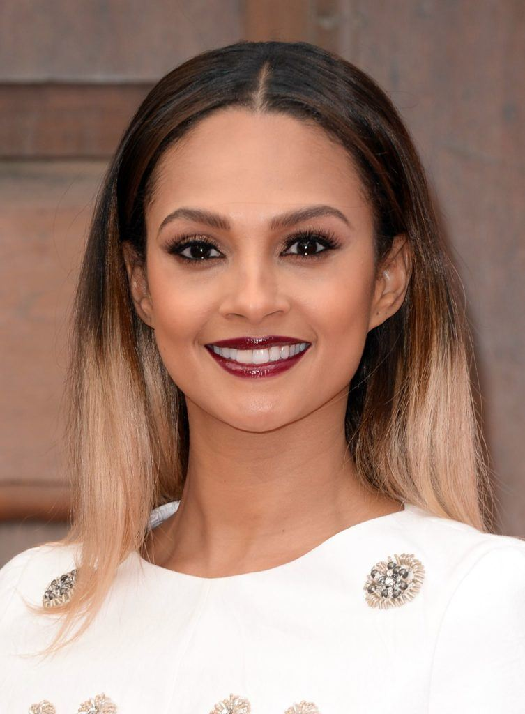 close up shot of alesha dixon with black and blonde ombre hair, wearing white shirt and posing on the red carpet