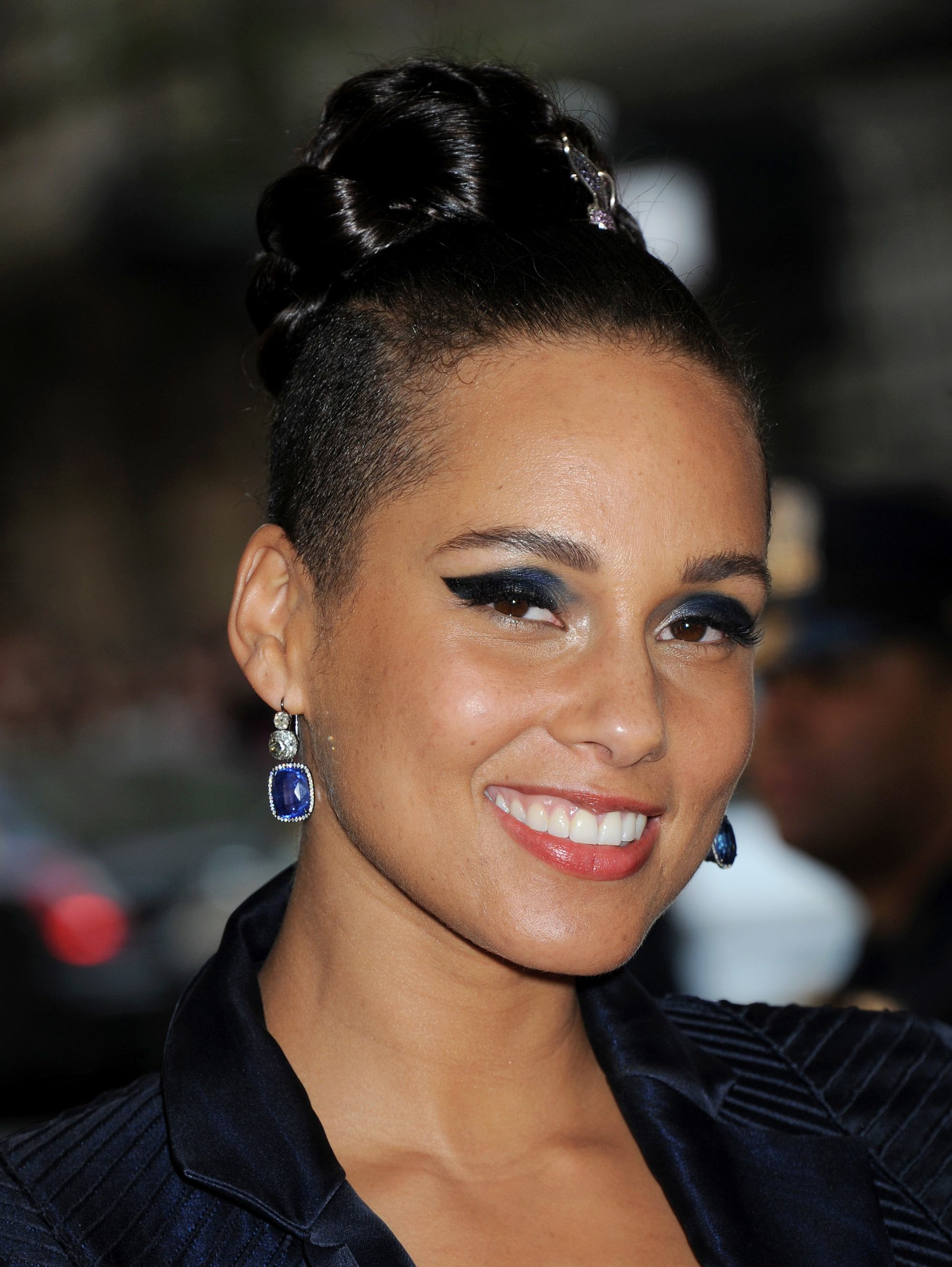 alicia keys at the 2015 costume institute gala benefit with a braided bun hairstyle with a shaved undercut