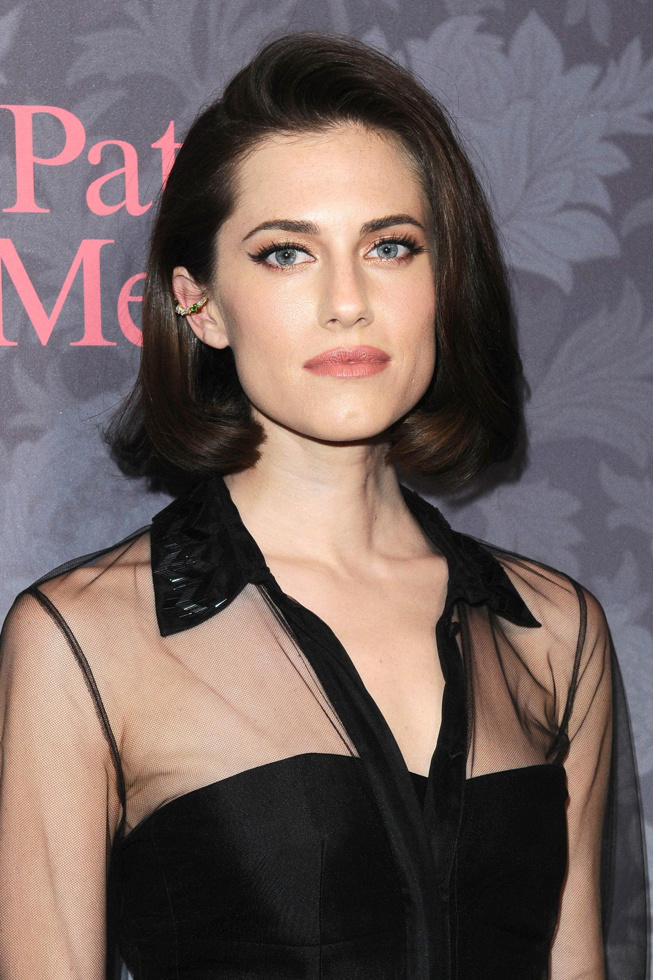 Bob hairstyles: Allison Williams with her dark brown short bob cut styled into a rolled retro bob