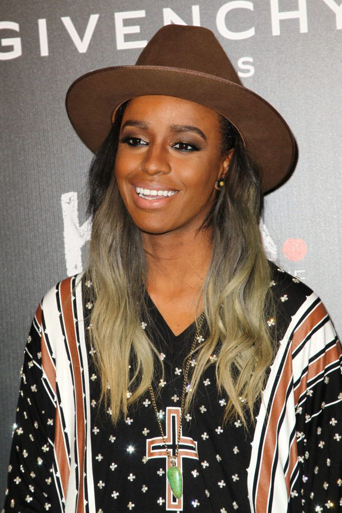 close up shot of angel haze with ombre hair, wearing hat and posing on the red carpet