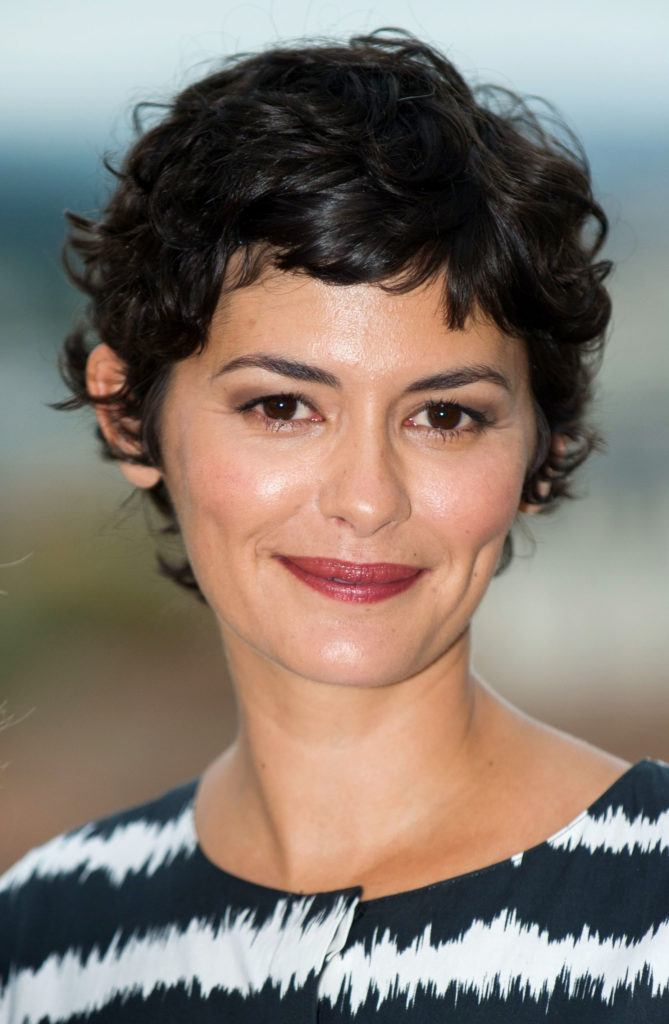 close up shot of audrey tautou with curly hair pixie haircut