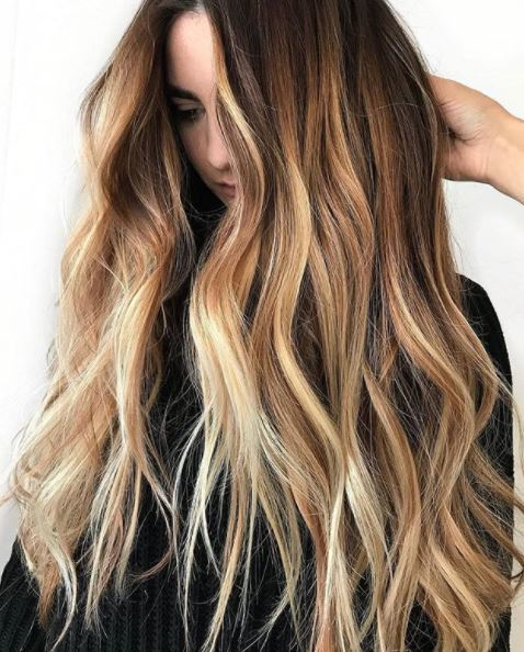 woman with very long wavy brown ombre hair