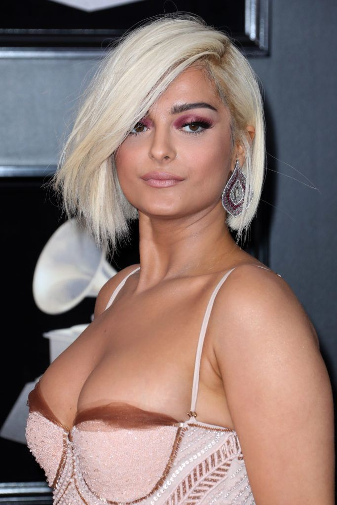 close up shot of bebe rexha with blunt cut bob hairstyle, wearing pink gown on the 60th Annual Grammy Awards red carpet