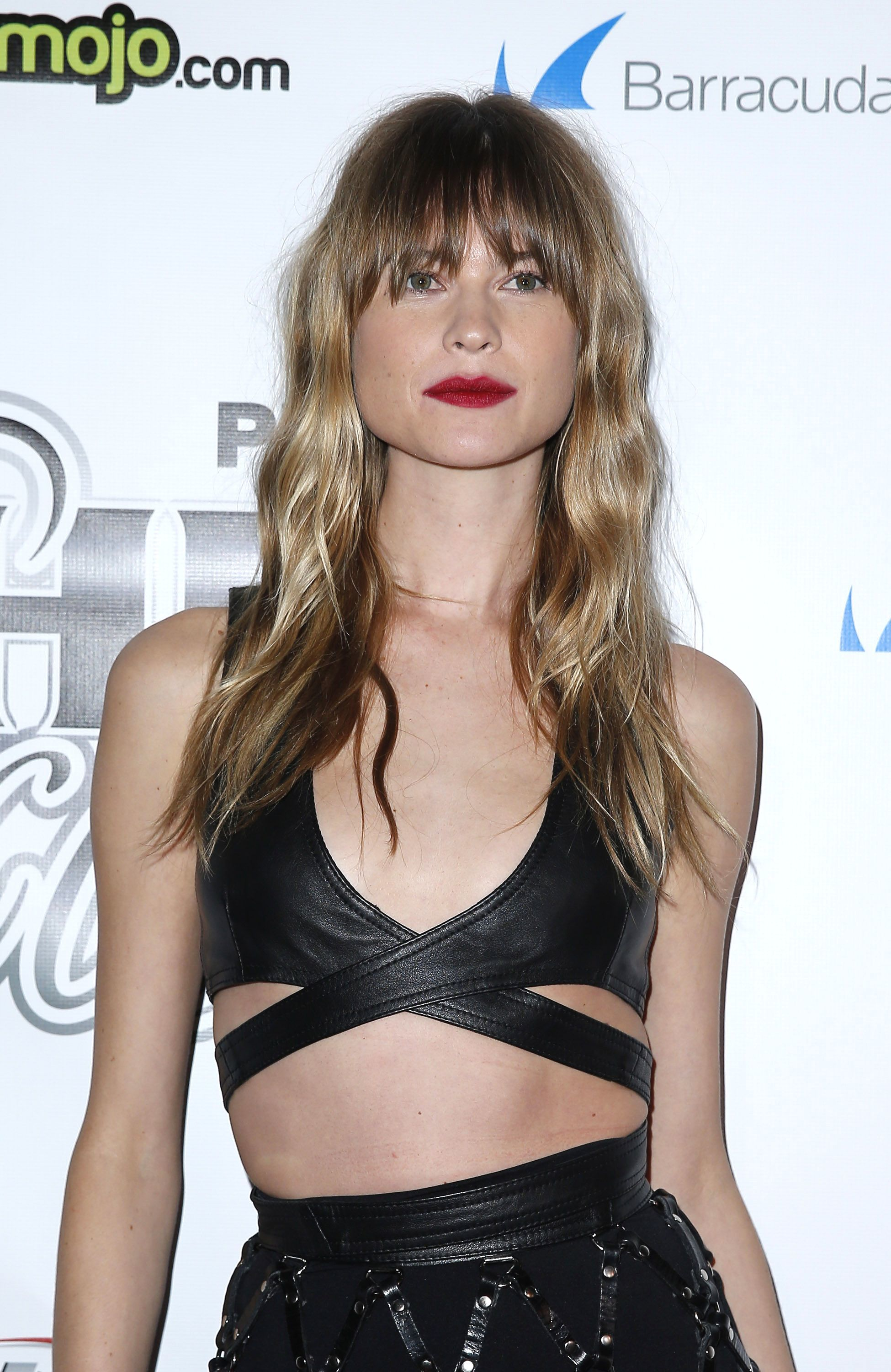 long layered hair bangs: close up shot of behati prinsloo with messy bangs, with wavy layers on the red carpet