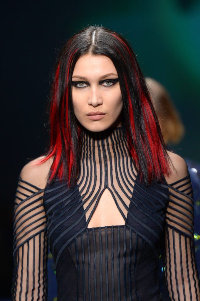 bella hadid red highlights runway medium length hair