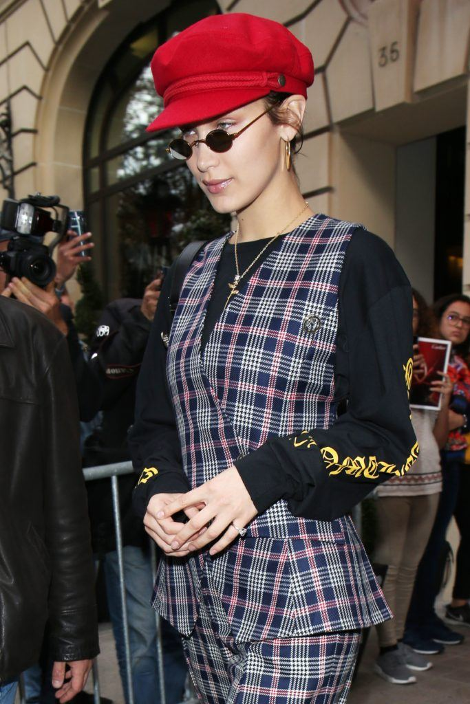 bella hadid baker boy hat and micro sunglasses trend
