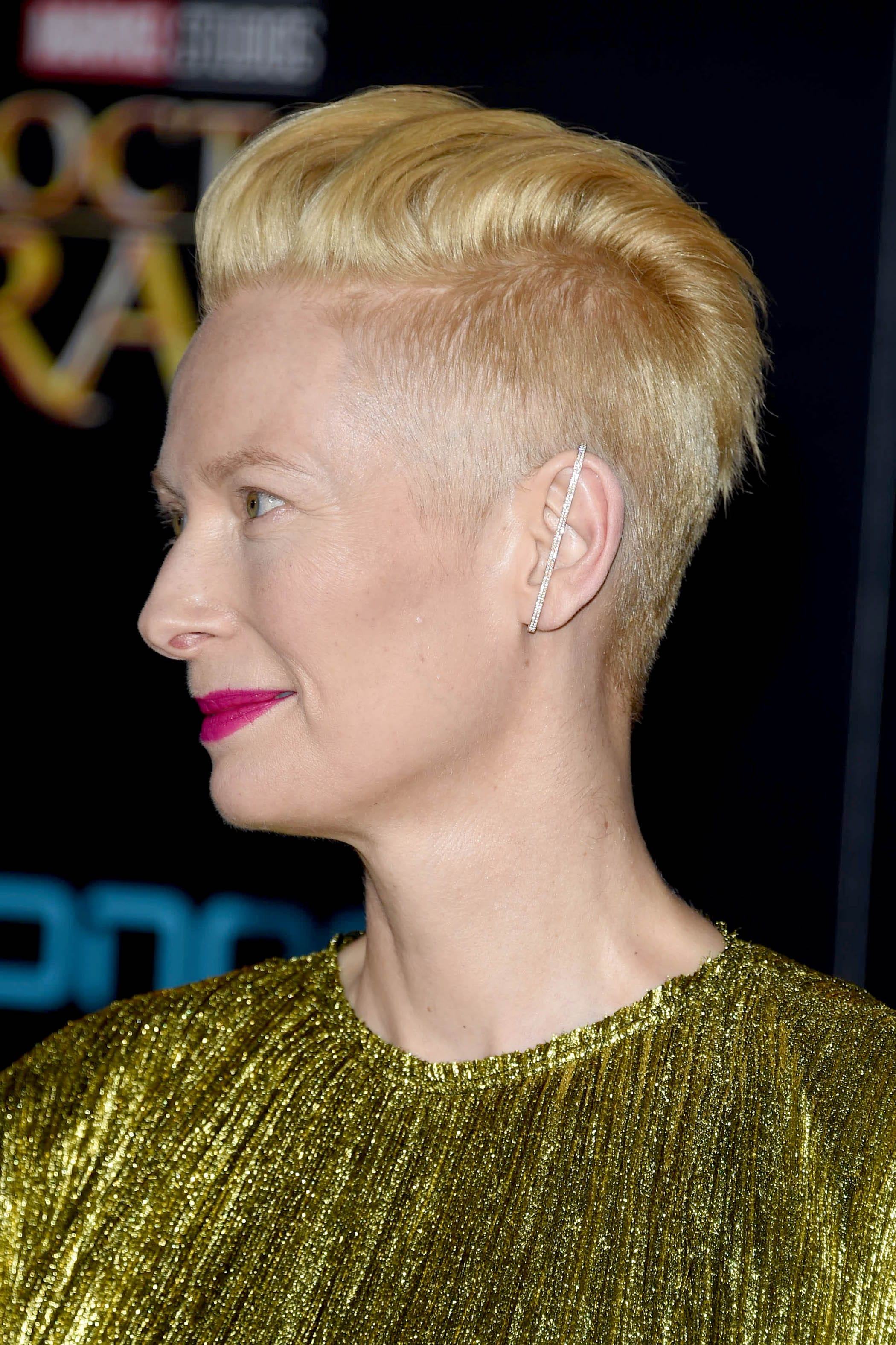 side view of tilda swinton with blonde undercut pixie