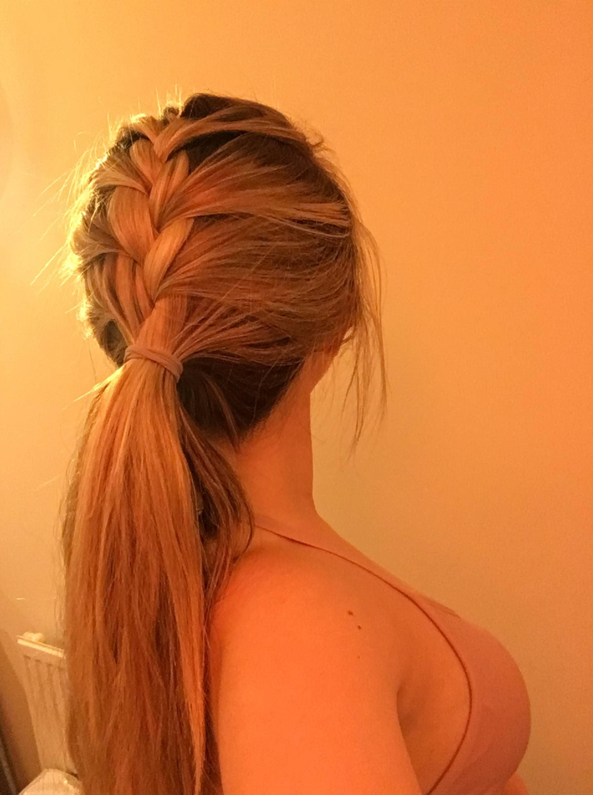 back view of Beth JBE at ATH with a French braided ponytail