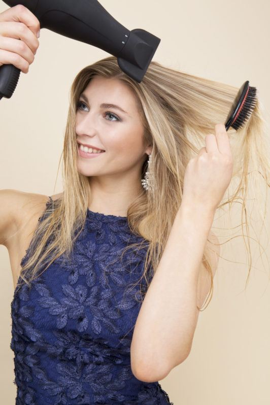How to curl hair with a flat iron blonde girl using blow dryer and brush