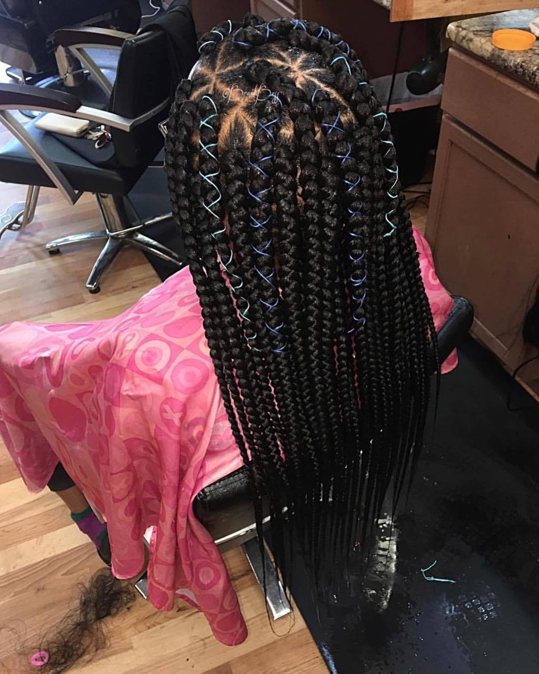 How long do box braids last girl in salon chair with braids