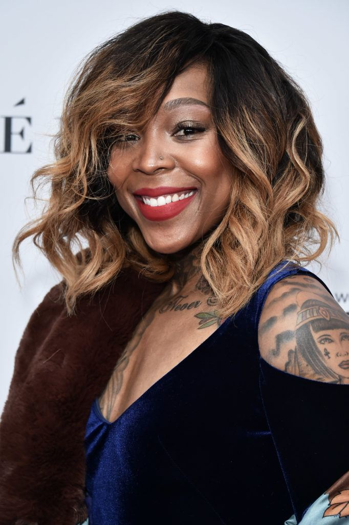 close up shot of cappie pondexter with ombre hair with side bangs on the red carpet, wearing blue dress and posing on the red carpet