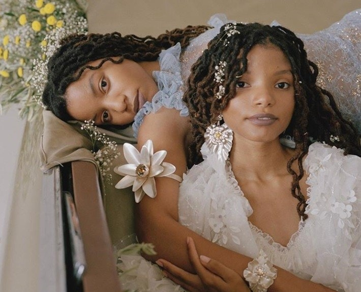 close up shot of chloe and halle, wearing natural hairstyles and posing for rodarte campaign