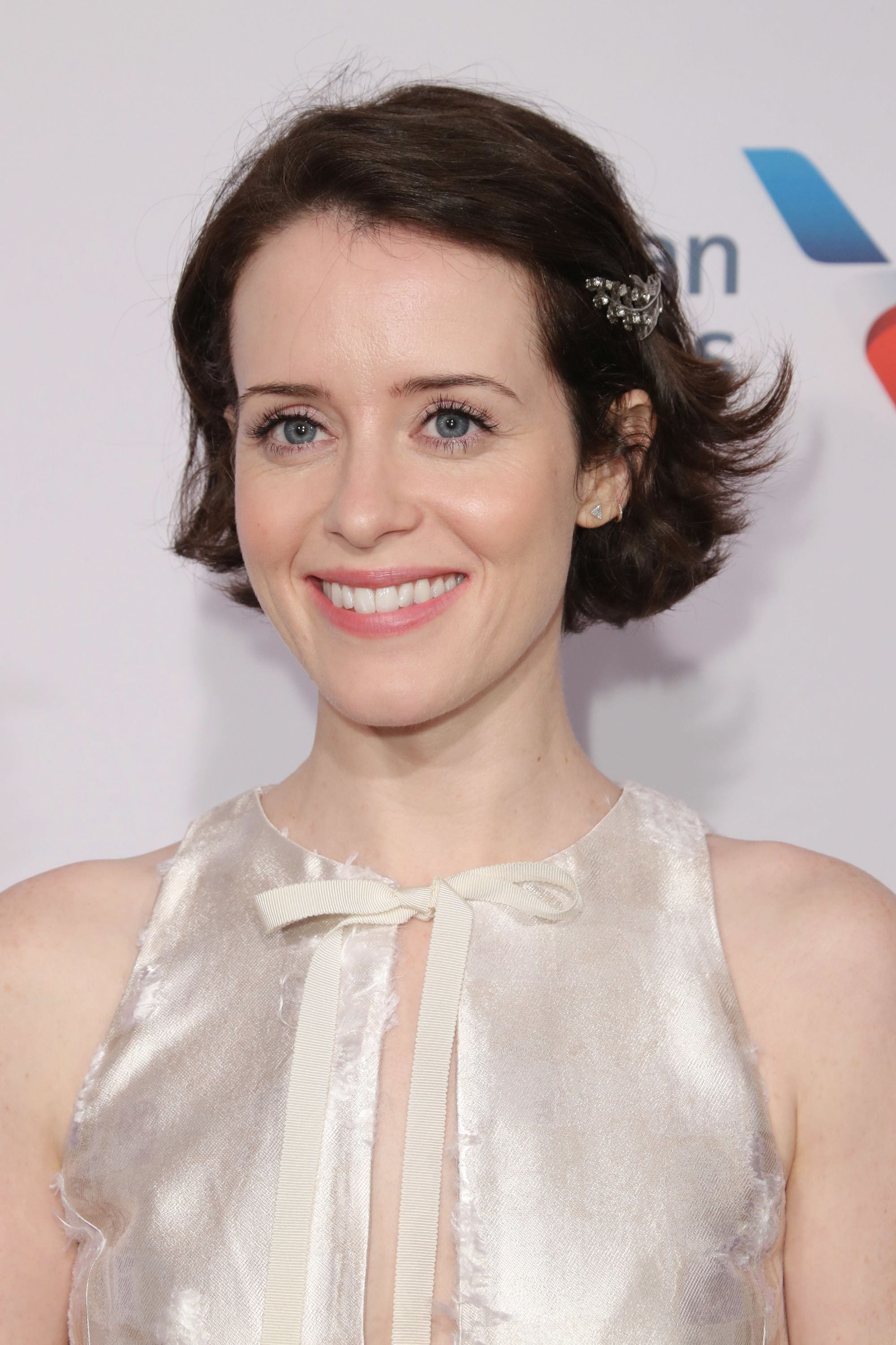 Bob hairstyles: Claire Foy with dark brown choppy chin length bob styled with a barrette