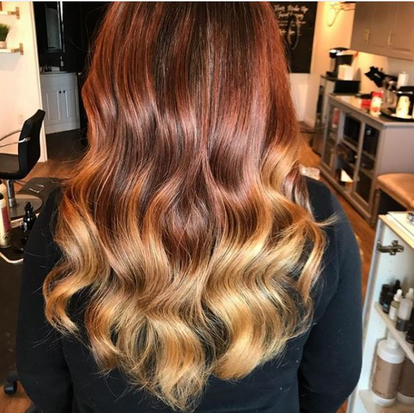 back view of long copper blonde ombre wavy hair
