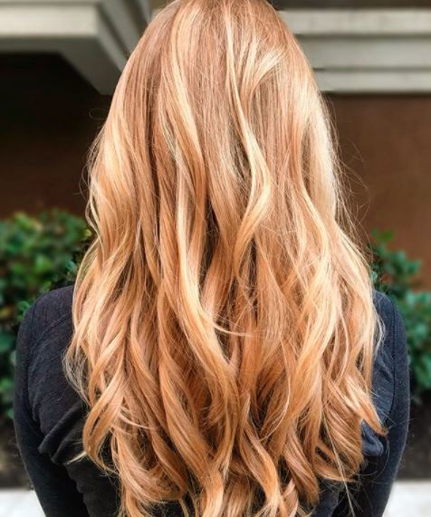 back view of woman with light copper blonde hair
