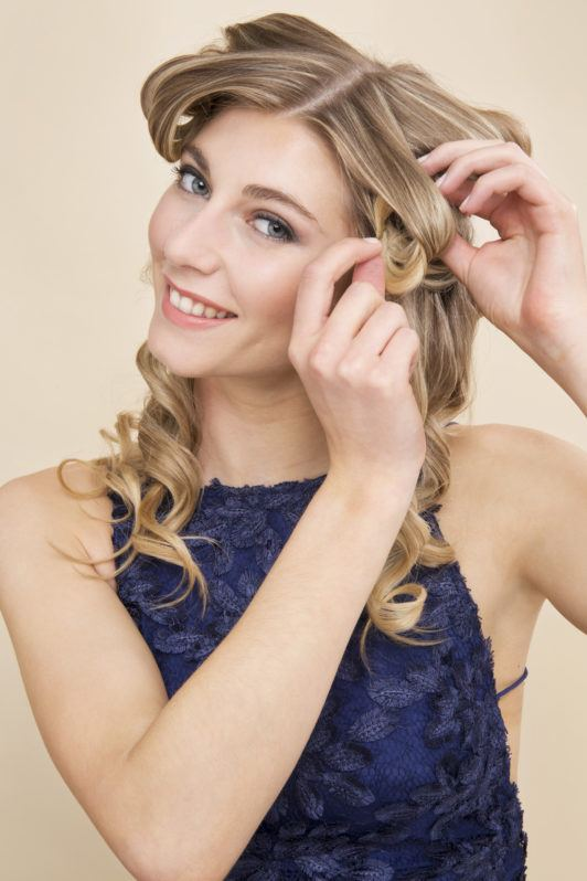 How to curl hair with a flat iron blonde girl pinning curls