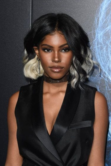 close up shot of diamond white with black and silver blonde ombre hairstyle, wearing all black on the red carpet