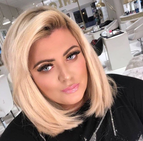 close up shot of gemma collins with new bob haircut, wearing black at the salon