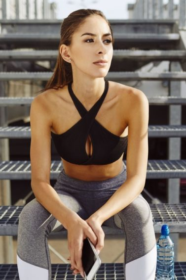 brunette woman in sporty gym clothes
