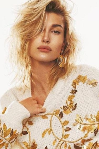 front view of hailey baldwin with shoulder length blonde tousled hair