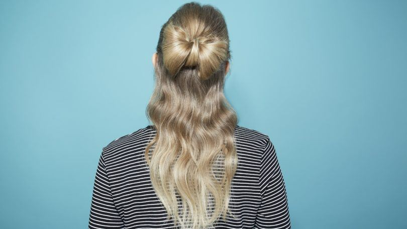 Hair bow blonde girl with back to camera