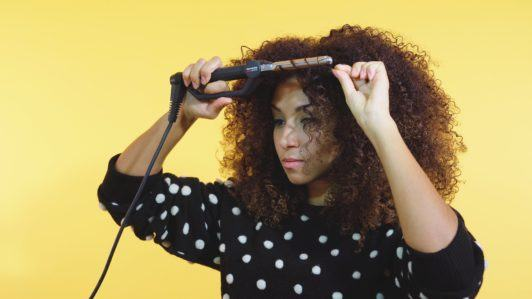 How to style curly hair girl using a curling tong on curly hair