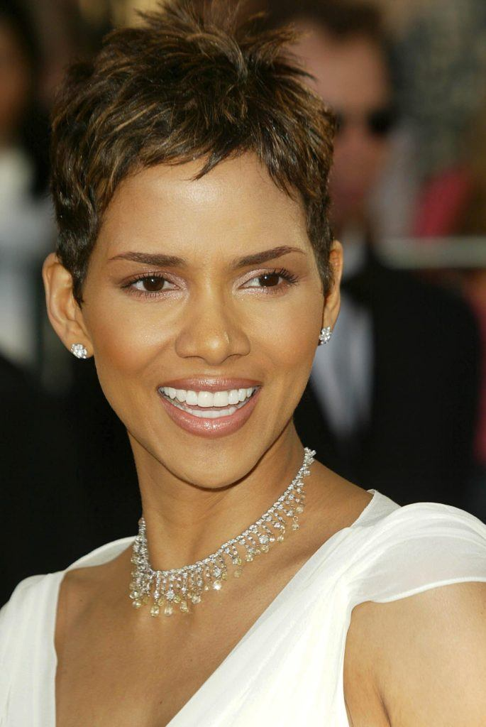 close up shot of halle berry with pixie haircut, wearing rhinestone necklace and white dress on the red carpet