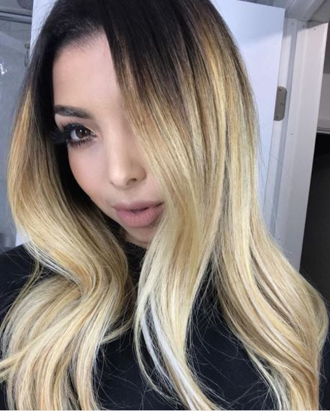 woman with heavy blonde ombre on long hair