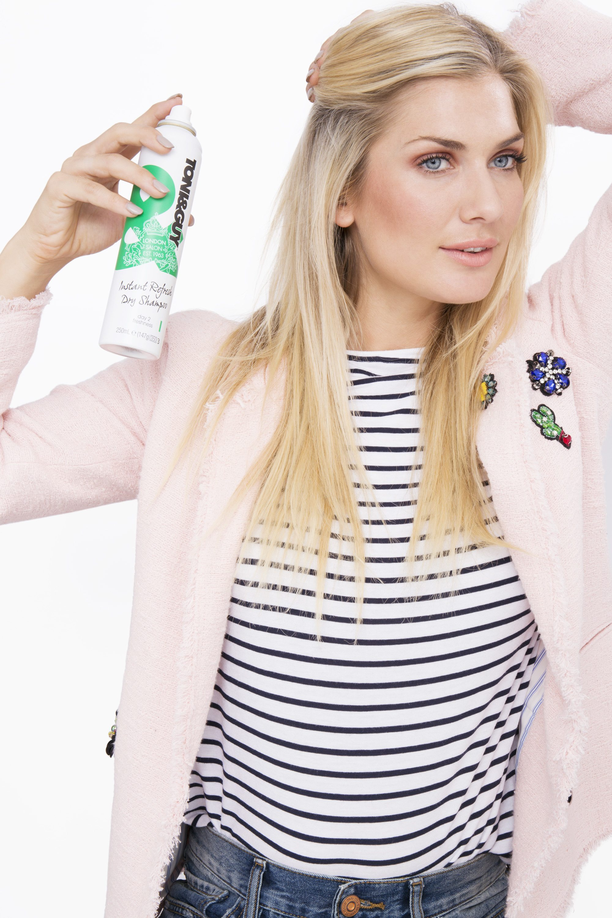 Is dry shampoo bad for your hair blonde girl spraying dry shampoo