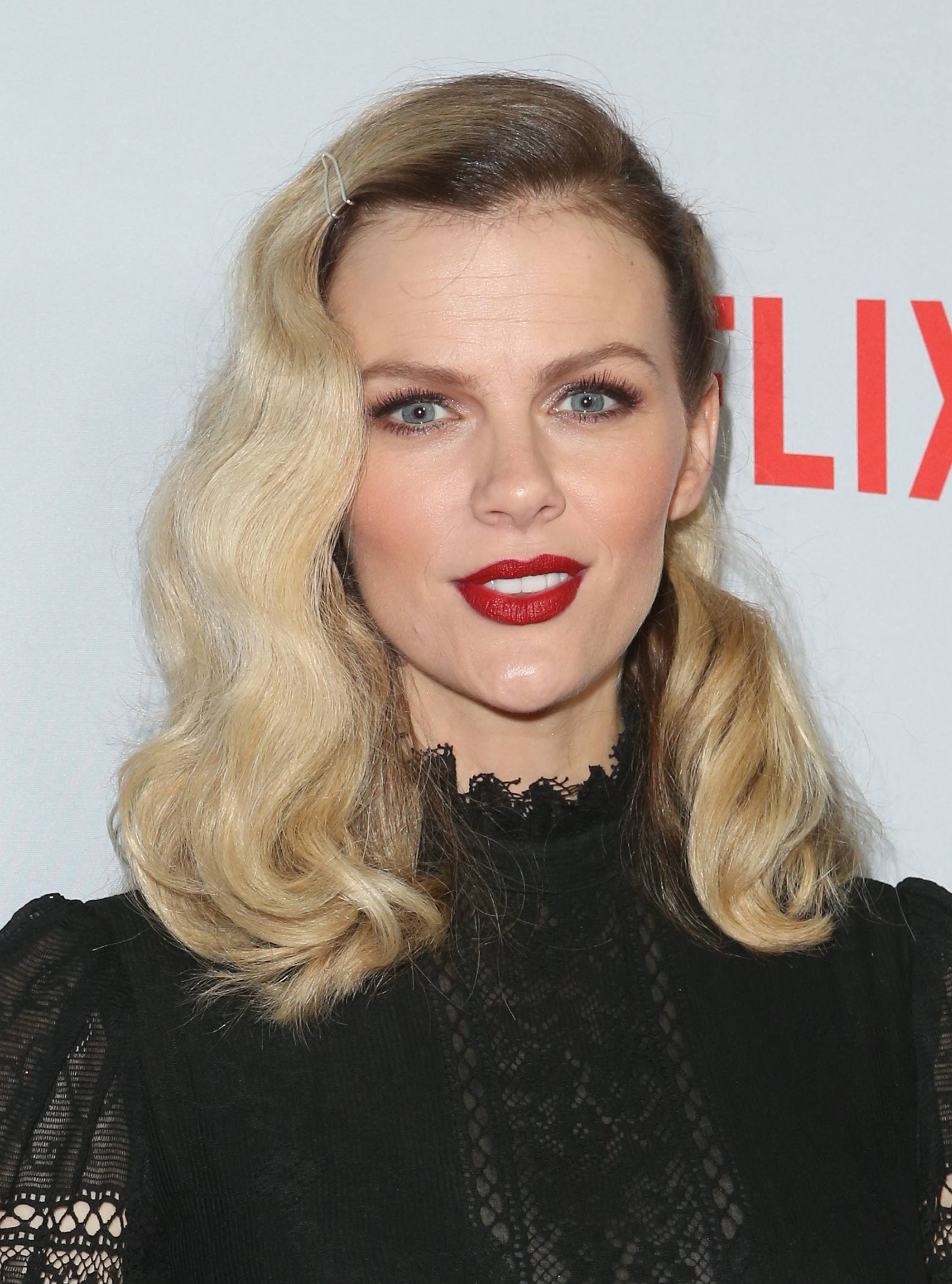 short to medium haircuts: close up shot of Brooklyn Decker with medium length hollywood waves, posing on the red carpet and wearing all blacl