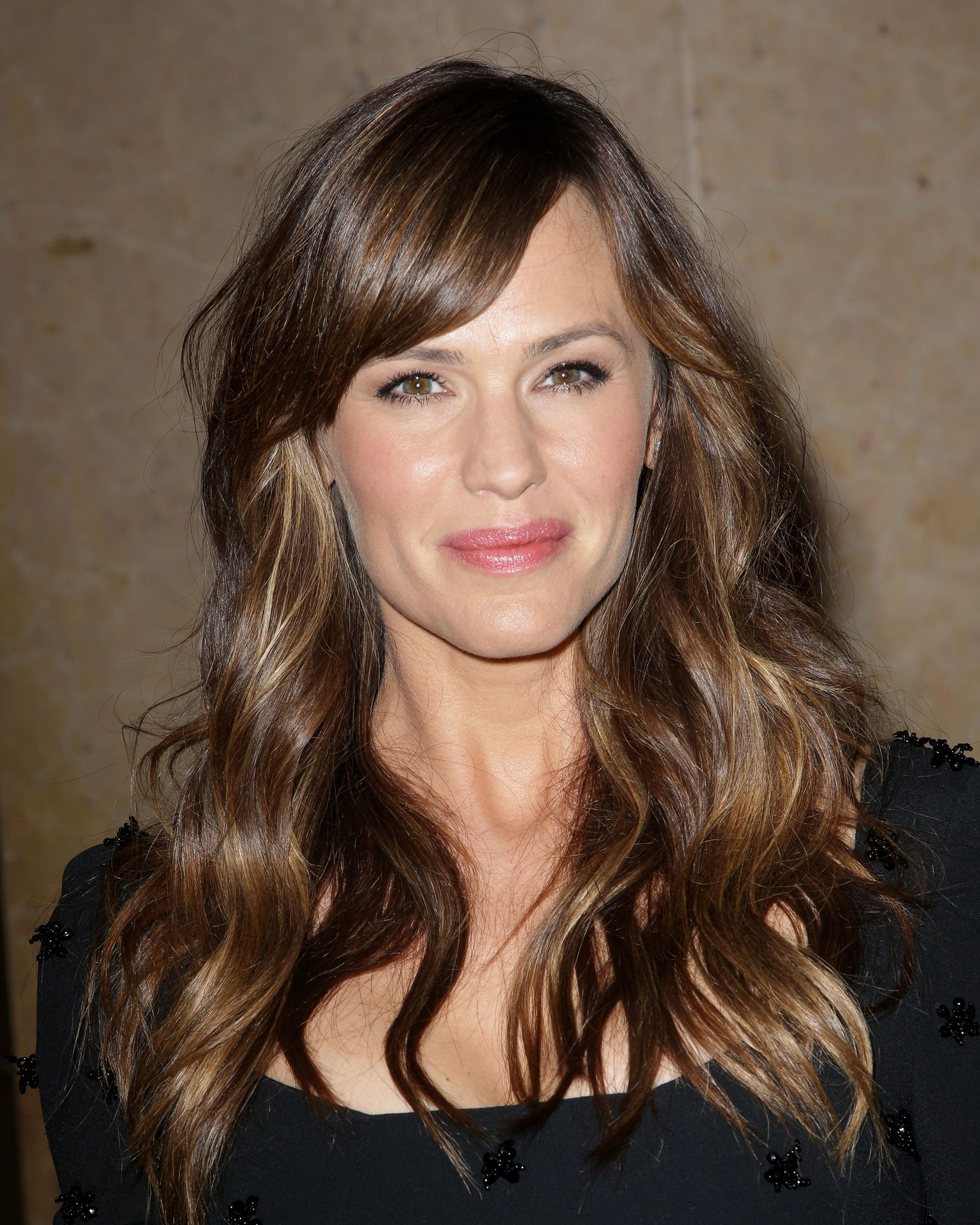 actress jennifer garner with long curly brunette hair and side bangs