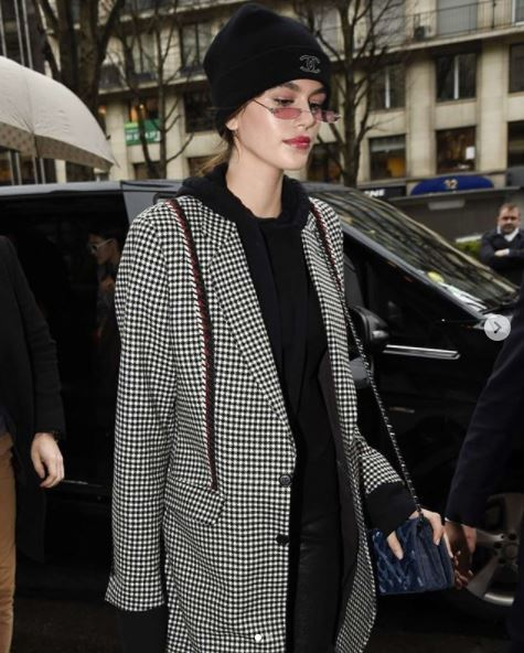 kaia gerber low ponytail wearing beanie hat and small sunglasses